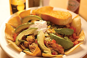 Chicken fajita salad with sliced avocado