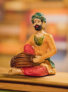 Figurine of man playing drum