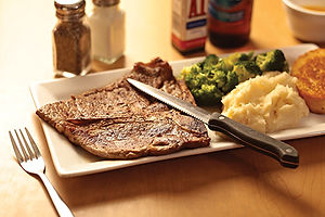 T-Bone steak with mashed potatoes and steamed broccoli