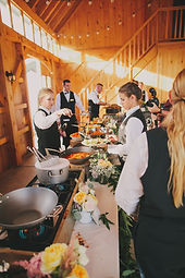 Mistura Catering staff setting up a Buffet Table