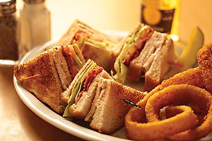 Club Sandwich with crispy onion rings