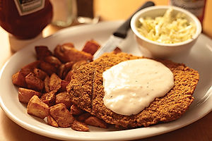 Country fried steak with gravy and country potatoes