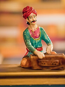 Figurine of man playing instrument