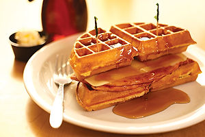 Ham and cheese waffle sandwich with syrup