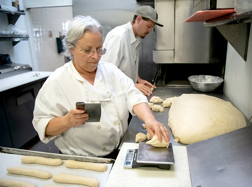 Mama and Her Young Assistant Preparing Dough to Make Sandwich Bread