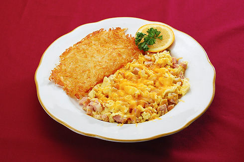 Diced ham and eggs scrambled with cheddar cheese, with crispy hash browns
