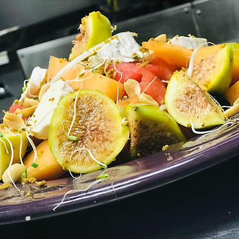 Organic Fruit Salad with figs, melon, cheese, almonds, pistachios and a dressing of vinegar, fresh ginger and lemon