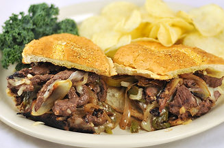 Philly Cheese Steak Sandwich with potato chips