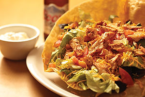 Taco Salad with chicken in a crispy tortilla shell