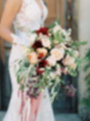 Bride holding a large bouquet of flowers