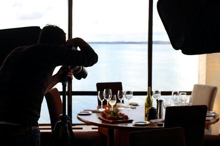 Photographer taking photos of a restaurant's dinner setting
