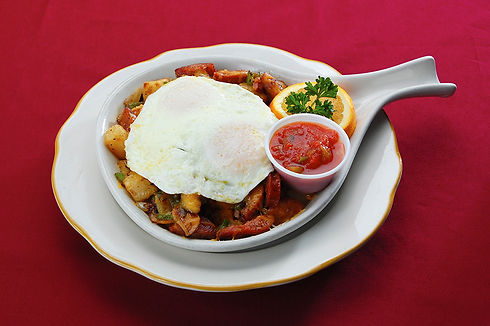 Skillet Breakfast of country potatoes, mushrooms, peppers, onions and linguica topped with 2 fried eggs, with a side of salsa