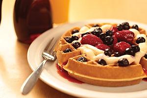 Berry waffles with dulce de leche cream sauce