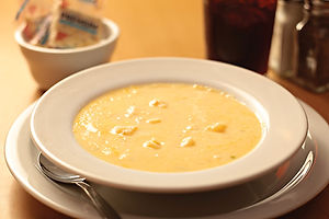 Bowl of clam chowder with crackers