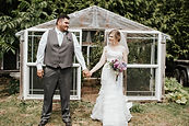 Kylie Megan Photography of bride and groom's first look in Bow while bride holds beautiful purple bouquet