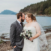 Bride and groom's first look by S and J Photography on Samish Island; Bride is holding gorgeous bouquet of dahlias and eucalyptus by Fir Island Floral Smith