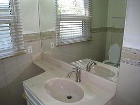 vanity cabinet - cultured marble top - mirror