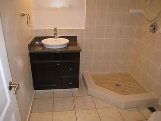 vanity with vesse basin and faucet