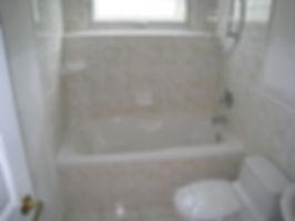 soaker bathtub with tile skirt