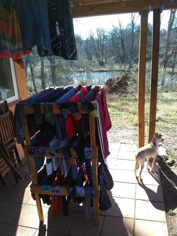 Clothes drying rack with a view of the pond