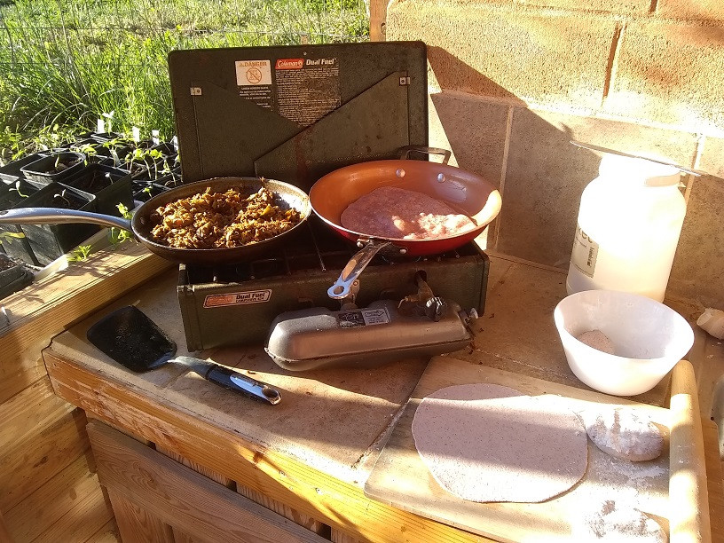 Dual-fuel Coleman stove with tortillas