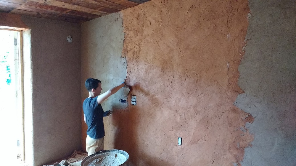 applying a second coat of lime plaster