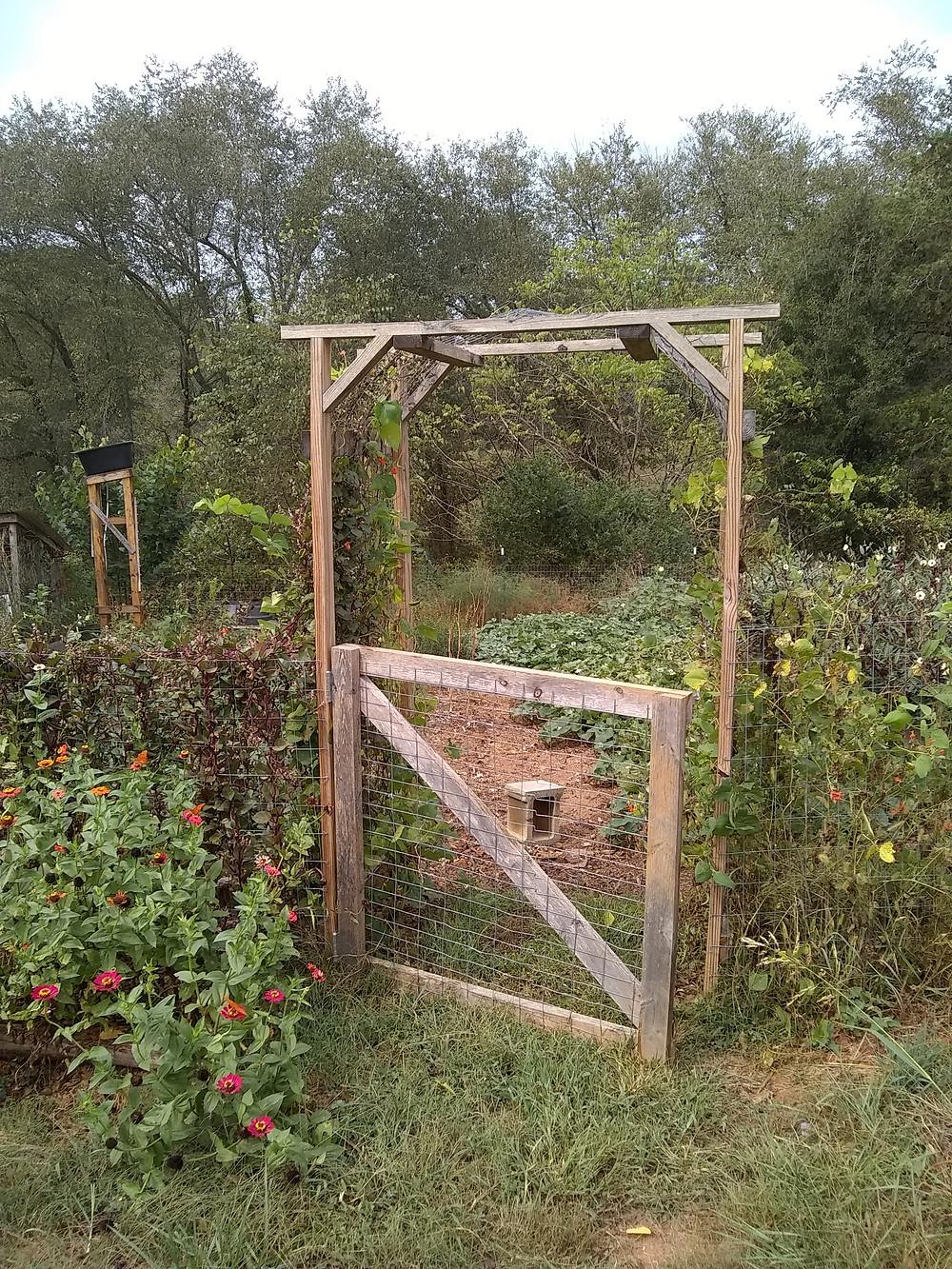 Garden gate with a solar garden shower