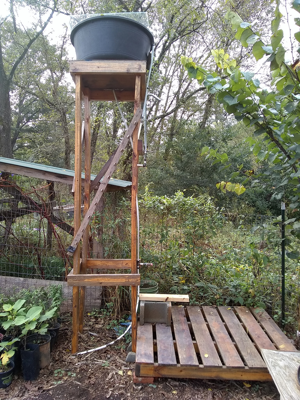 Solar-heated shower from repurposed materials