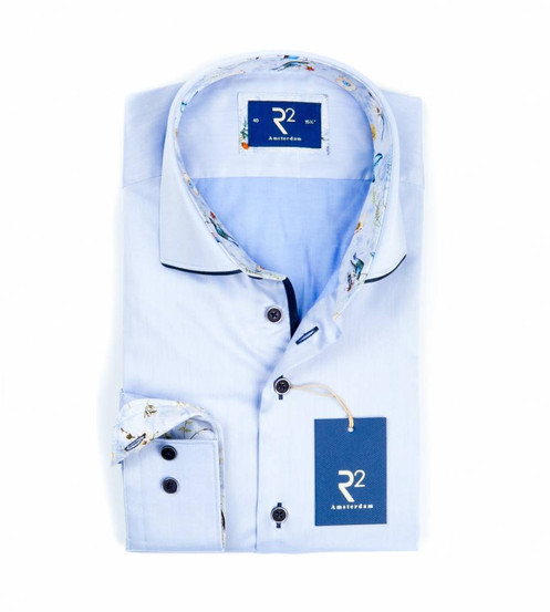 2c801344c This light blue shirt with a widespread collar has a light blue flower with  bird contrast in the collar and cuffs.