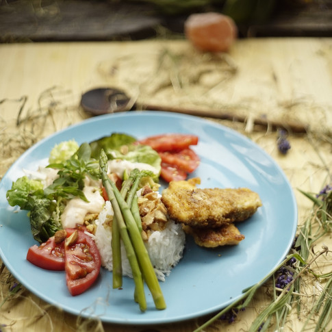 Homemade fish fingers with fluffy basmati and crunchy vegetables