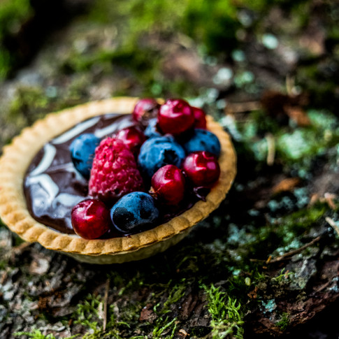 A chocolate ganache and mixed berry tart