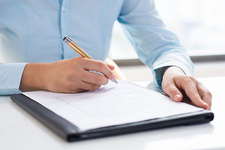 A person is writing the Hifinite's Medication adherence Services Terms and Conditions in a legal document with a pen