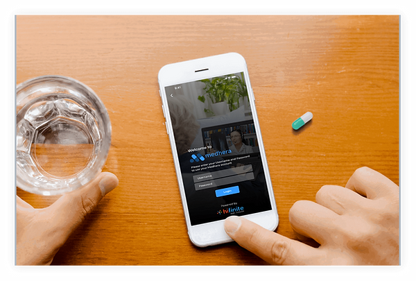 A mobile screen showing Medhera (the best med adherence app in the US) login having a glass of water and the capsule nearby