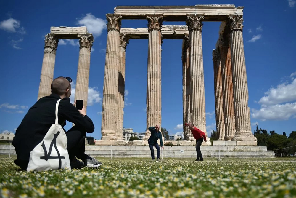 "Prinz Gholam's ""My sweet country"" at the Temple of Olympian Zeus in Athens . Photo: Louisa Gouliamaki/AFP/Getty Images. Artworks Advisory"