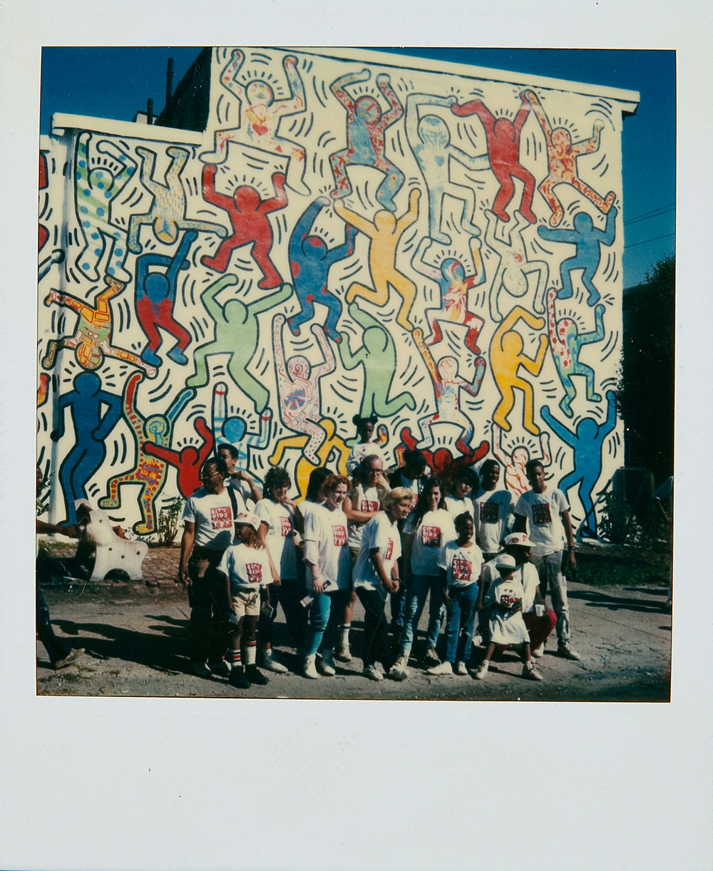 Polaroid and mural by Keith Haring, We the Youth, Philadelphia Mural, 1987. Courtesy of The Keith Haring Foundation Archives. Artworks Advisory