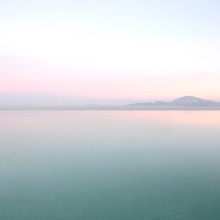 Evening light across the infinity pool towards Morocco from Spain