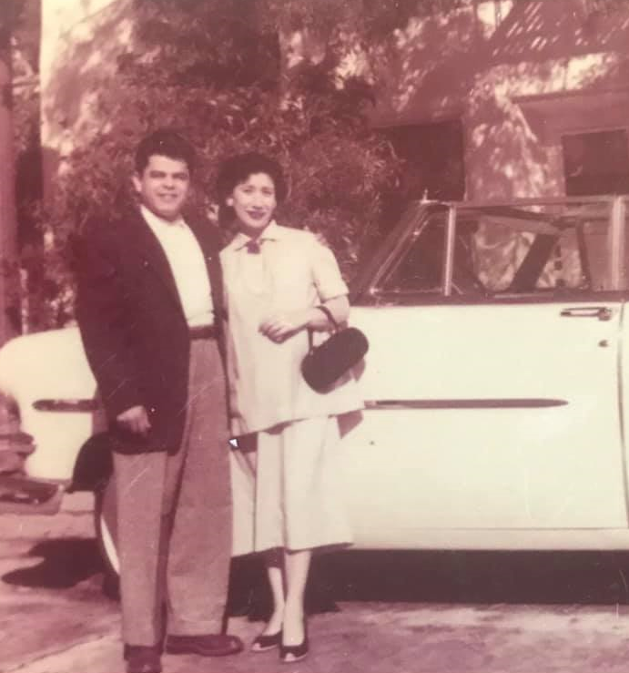 mom and dad with car.png