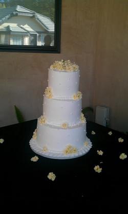 three tier wedding cake yellow