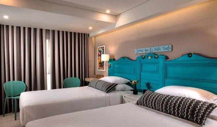 casa verano - bedroom 2 double beds.jpeg