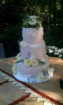 three tier white rose wedding cake