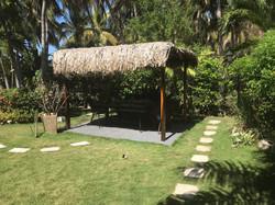 casa verano tropical garden dining area.