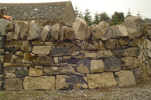 Walls Rebuilt. This historic wall was built by Scottish wallers around the estate of a local landlord in the 19th century. The client had a strong appreciation of the value of this historic dry stone wall and commissioned EarthStone to move the old wall back 4m from the roadside in order to comply with their planning obligations. If you want to keep that lovely old dry stone wall then EarthStone can help. No need to repalce it we can move it for you.