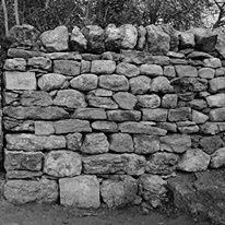 'Built to last'. This end of a double free-standing dry stone wall has been well sorted before building allowing for the best use of the stone and so giving a stable and long lasting structure. At EarthStone we build to last and offer a lifetime guarantee on all our walls.