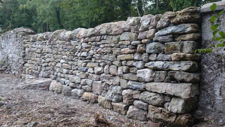 Free-standing double dry stone walls. Limestone field stone makes for an attractive dry stone wall like in this gap repair in County Offaly.