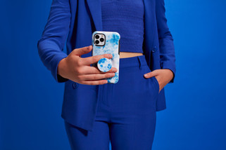 Woman in a blue suit holding Iphone