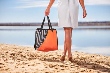 Woman on beach with bag