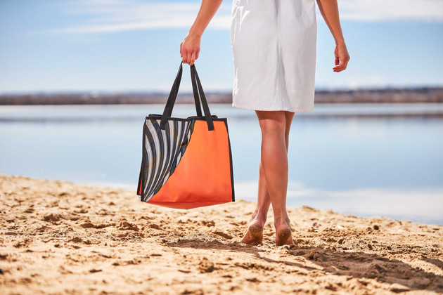 Woman on beach with bag