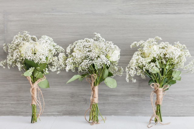 The Bridesmaids bouquets, tie with the natural rope.