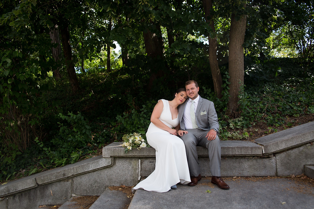 bride and groom in Delaware Park Hoyt Lake in Buffalo NY