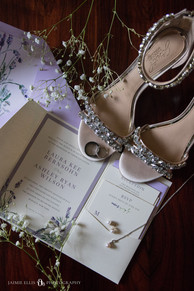 wedding details with invitation suite bride's shoes jewelry and couple's rings